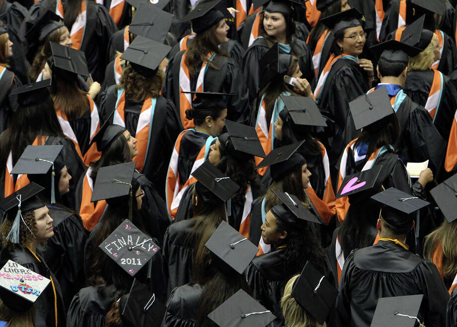 Graduating students looks for family and friends as they take their seats during the Spring commencement ceremonies at UTSA for the College of Education and Human Development in 2011. There has been an increase in the number of Texas students continuing to college, but SAT scores indicate that too many are not academically prepared when they get to college. This must change. Photo: KIN MAN HUI /SAN ANTONIO EXPRESS-NEWS / San Antonio Express-News