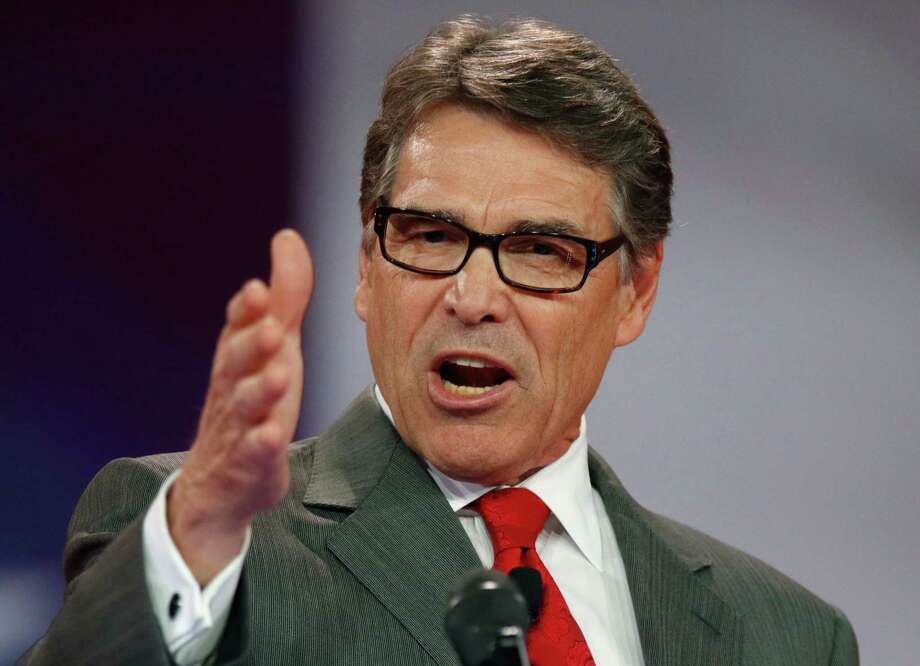 FILE - In this Aug. 22, 2015, file photo Republican presidential candidate, former Texas Gov. Rick Perry speaks at the Defending the American Dream summit hosted by Americans for Prosperity at the Greater Columbus Convention Center in Columbus, Ohio. Perry, on Sept. 11, announced he is dropping out of the 2016 race for president. (AP Photo/Paul Vernon, File) Photo: Paul Vernon, FRE / FR66830 AP