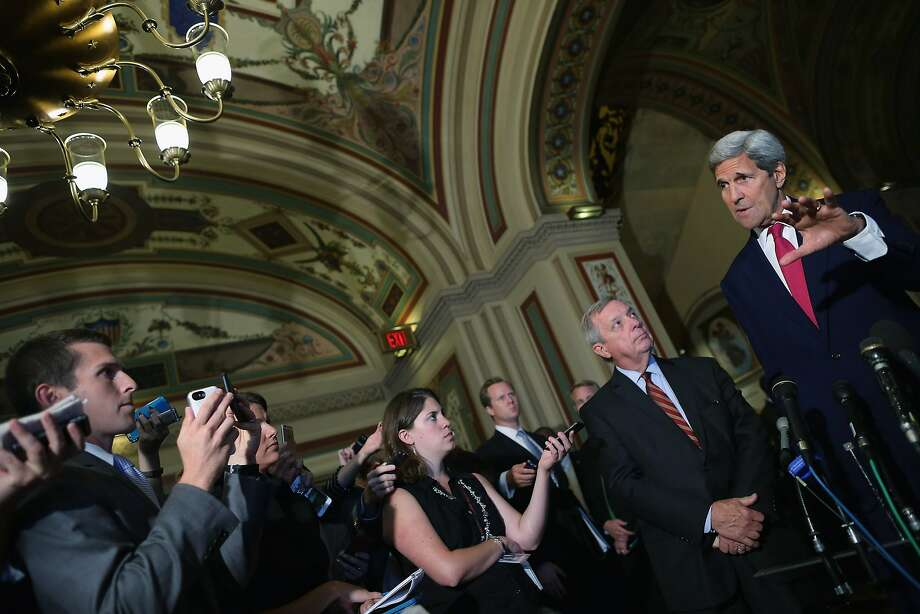 WASHINGTON, DC - SEPTEMBER 09:  U.S. Secretary of State John Kerry (R) answers reporters' questions after meeting with Senate Minority Whip Richard Durbin (D-IL) (2nd R) and other members of Congress at the U.S. Capitol September 9, 2015 in Washington, DC. Joined by Energy Secretary Ernest Moniz, Kerry briefed members of the House and Senate about the Syrian refugee crisis in Europe and the Iran nuclear deal.  (Photo by Chip Somodevilla/Getty Images) Photo: Chip Somodevilla, Getty Images