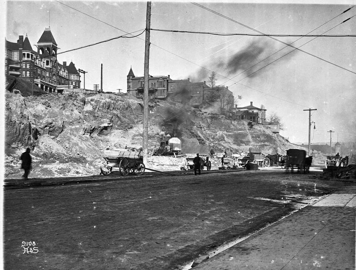 Work underway on the Denny Hill Regrade at Pine Street between Second Avenue and Third Avenue, pictured in 1905.