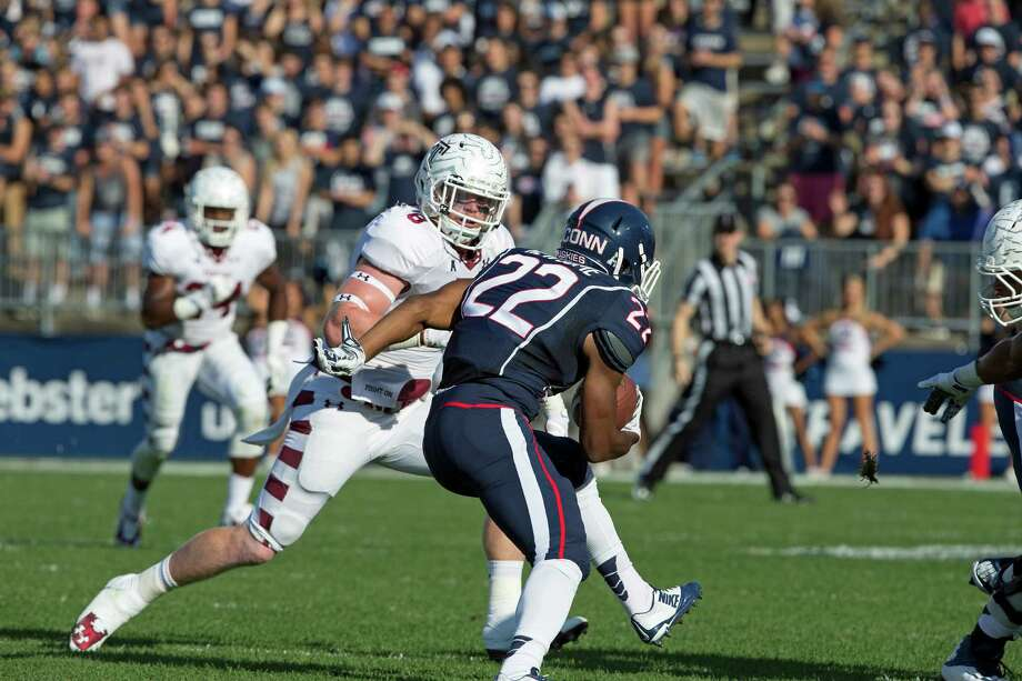 Stratford's Tyler Matakevich, a senior linebacker at Temple, was named the national Bednarik Award Player of the Week after his three sacks Sept. 5 in a 27-10 win over Penn State. Matakevich is shown in this 2014 file photo chasing Ansonia's Arkeel Newsome in Temple's 36-10 victory at UConn. Photo: Joseph V. Labolito (Temple University) / Contributed / Joseph V. Labolito (Temple University) / Contributed
