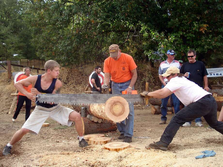 Axe-throwing and log-cutting competitions rival a parade, food and drink at the Lumberjack Day celebration in tiny West Point, Calaveras County. Photo: Rick Torgerson