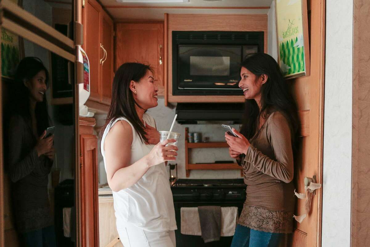 """(L-R) Tina Lee and Anica John, co-founders of Mommy Pod Moblie talk in the kitchen of a converted RV on Friday, Sept. 11, 2015 in San Francisco, Calif. The RV acts as an """"experimental"""" mobile breast milk pumping station which is operating for the first time outside the Tech Inclusion 2015 conference."""