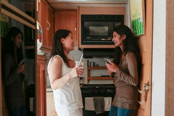 "(L-R) Tina Lee and Anica John, co-founders of Mommy Pod Moblie talk in the kitchen of a converted RV on Friday, Sept. 11, 2015 in San Francisco, Calif.   The RV acts as an ""experimental"" mobile breast milk pumping station which is operating for the first time outside the Tech Inclusion 2015 conference."