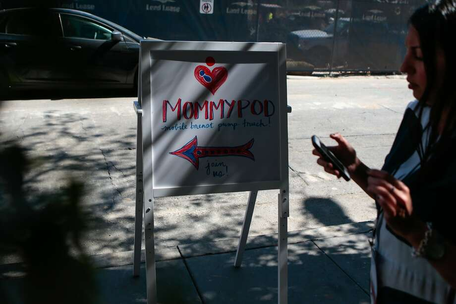 "Sepideh Nasiri, a speaker at Tech Inclusion, walks past the sign meant to direct recent mothers to the Mommy Pod RV on Friday, Sept. 11, 2015 in San Francisco, Calif.   The RV acts as an ""experimental"" mobile breast milk pumping station which is operating for the first time outside the Tech Inclusion 2015 conference. Photo: Nathaniel Y. Downes, The Chronicle"