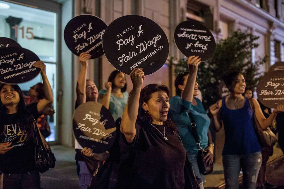 Former janitors protest at WeWork, a co-working startup where customers can find jobs and team up with one another on new, socially responsible ventures. The janitors lost their jobs in a dispute with their contractor. WeWork is defending itself against charges that it is callous. Photo: KIRSTEN LUCE, STR / NYTNS