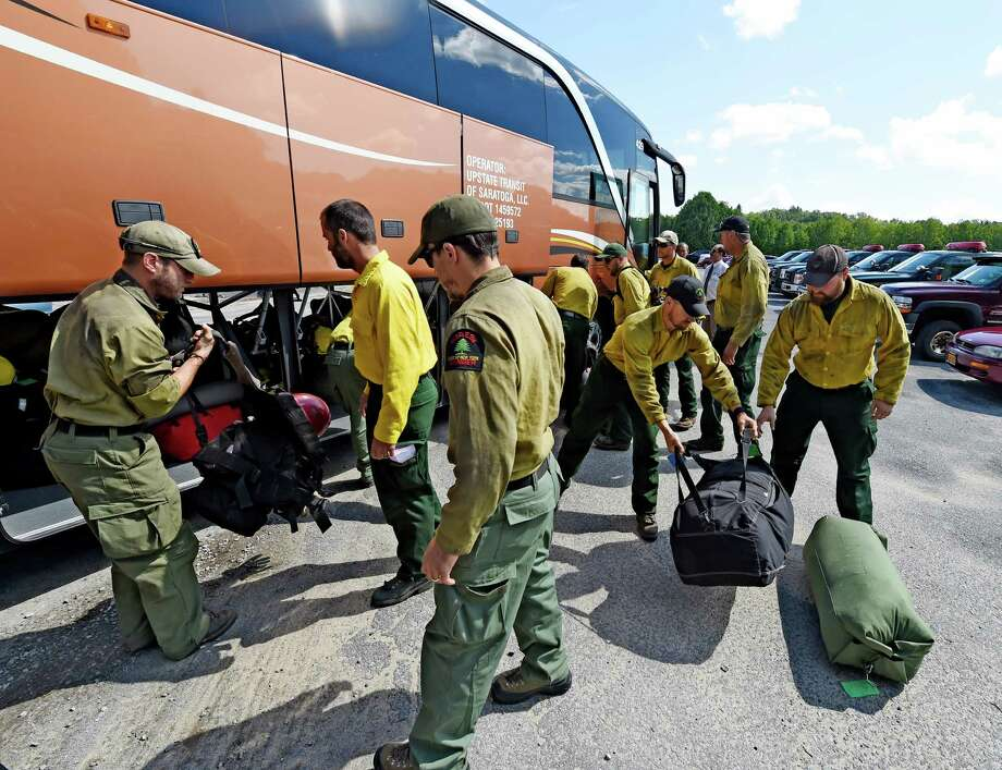 The second 20-member crew of Forest Rangers, employees and volunteers from the New York State Department of Environmental Conservation unload their luggage after returning from California after a two weeks of battling fires on the Mad River Complex Friday afternoon, Sept. 11, 2105, at Saratoga Tree Nursery in Saratoga Springs, N.Y. (Skip Dickstein/Times Union) Photo: SKIP DICKSTEIN / 00033333A