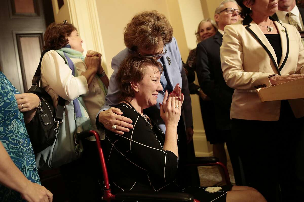 Christy O'Donnell, the spokesperson of the right-to-die movement in California, during a news conference after the End of Life Option Act was passed at the California State Capitol in Sacramento, Sept. 11, 2015. In a landmark victory for supporters of assisted suicide, the California State Legislature on Friday approved a bill that would allow doctors to help terminally ill people end their own lives. (Ramin Rahimian/The New York Times)