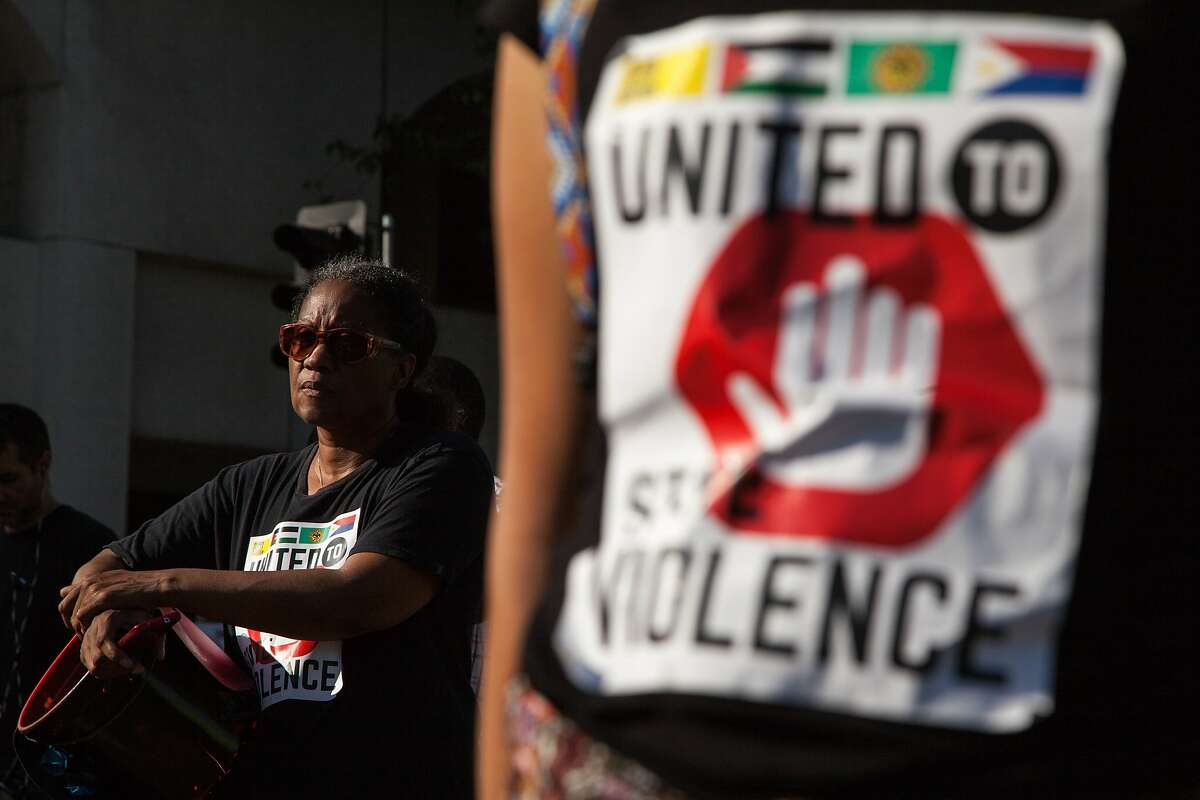 Regine Neptune, an organizer with Black Lives Matter, protests the Urban Shield convention, Friday, Sept. 11, 2015, at the intersection of 14th Street and Lakeside Drive in Oakland, Calif. The convention, which critics say increases the militarization of police, moved to a different venue after last year's event was the scene of large protests. Urban Shields presents training exercises to first responders. Neptune travelled from San Jose for the demonstration.