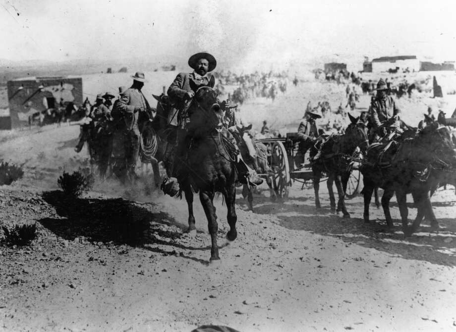 Pancho Villa leads his troops. (For more photos from the Mexican Revolution, scroll through the gallery.) Photo: Topical Press Agency, Getty Images
