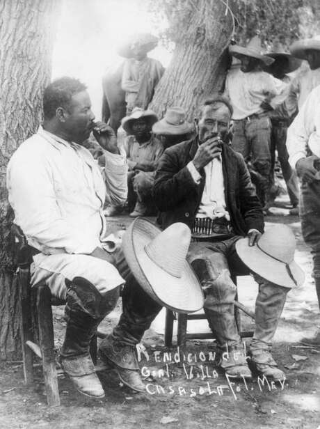 Pancho Villa and Emiliano Zapata smoke cigarettes together. Photo: Hulton Archive, Getty Images