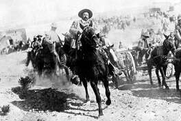 Mexican General Pancho Villa riding with his men after victory at Torreon.