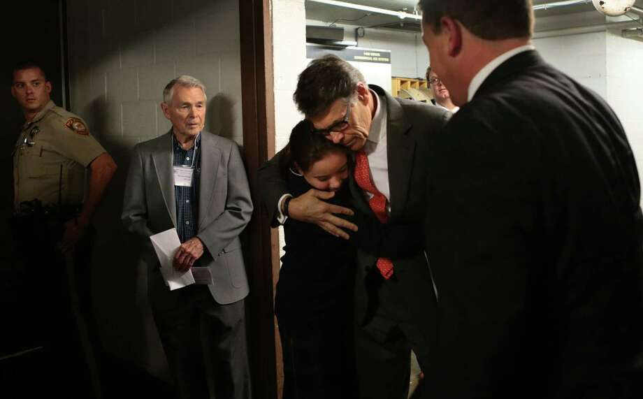 Former Texas Gov. Rick Perry hugs Madeline Martin, daughter of Eagle Forum President Ed Martin, right, in St. Louis. Perry told the Eagle Forum he was dropping out of the presidential race. Photo: Robert Cohen, MBI / St. Louis Post-Dispatch