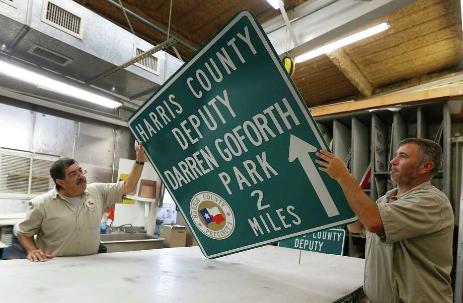 Harris County Precinct 3 leadsman Rudy Cisneros, left, and operator Brad Pettit, examine 