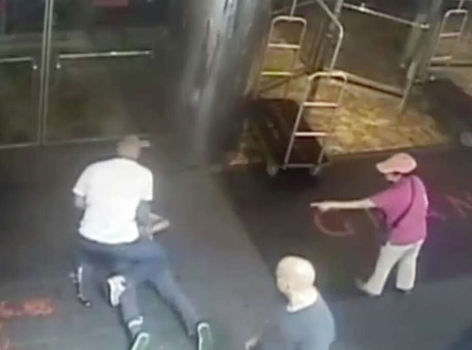 "This image taken from a surveillance camera and released by the New York Police Department shows former tennis star James Blake, on ground, being arrested by plainclothes officer James Frascatore outside of the Grand Hyatt New York hotel on Wednesday, Sept. 9, 2015, in New York. Blake was mistaken for an identity-theft suspect that Police Commissioner William Bratton said looked like Blake's ""twin."" Bratton apologized to Blake. (NYPD via AP) NO SALES Photo: Associated Press / NYPD"