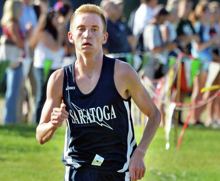 Saratoga's Aidan Tooker crosses the finish line far ahead of the competition during the 2015 Ed Springstead Invitational Cross Country Meet Friday Sept. 11, 2015 in Colonie, NY.  (John Carl D'Annibale / Times Union) Photo: John Carl D'Annibale / 00033302A