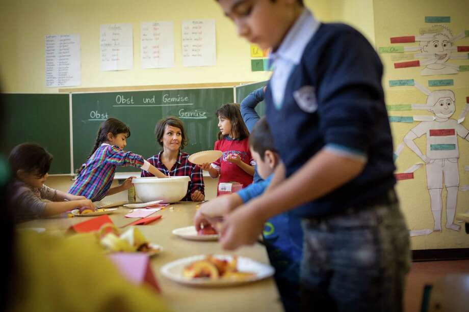German as a second language classes at the Johannesschule, a primary school in Erfurt, Germany, Sept. 9, 2015. Not all parents are happy with the attention and resources dedicated to non-Germans in Erfurt, a smaller city with little history of foreigners now working out how to cope with an unprecedented stream of largely Muslim migrants. (Gordon Welters/The New York Times) Photo: GORDON WELTERS, STR / New York Times / NYTNS