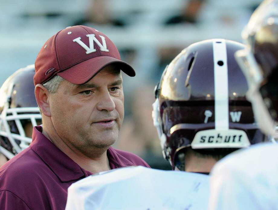 Whitehall head coach Rich Gould instructs his players against Rensselaer during their Class D high school football game in Rensselaer, N.Y., Friday, Sept. 11, 2015. (Hans Pennink / Special to the Times Union) ORG XMIT: HP101 Photo: Hans Pennink / 00033309A