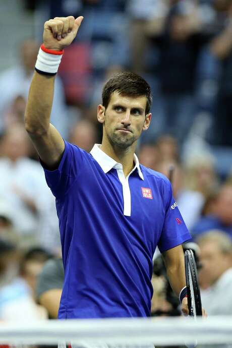 NEW YORK, NY - SEPTEMBER 11:  Novak Djokovic of Serbia celebrates after defeating Marin Cilic of Croatia during their Men's Singles Semifinals match on Day Twelve of the 2015 US Open at the USTA Billie Jean King National Tennis Center on September 11, 2015 in the Flushing neighborhood of the Queens borough of New York City. Djokovic defeated Cilic 6-0, 6-1, 6-2.  (Photo by Matthew Stockman/Getty Images) Photo: Matthew Stockman, Staff / 2015 Getty Images