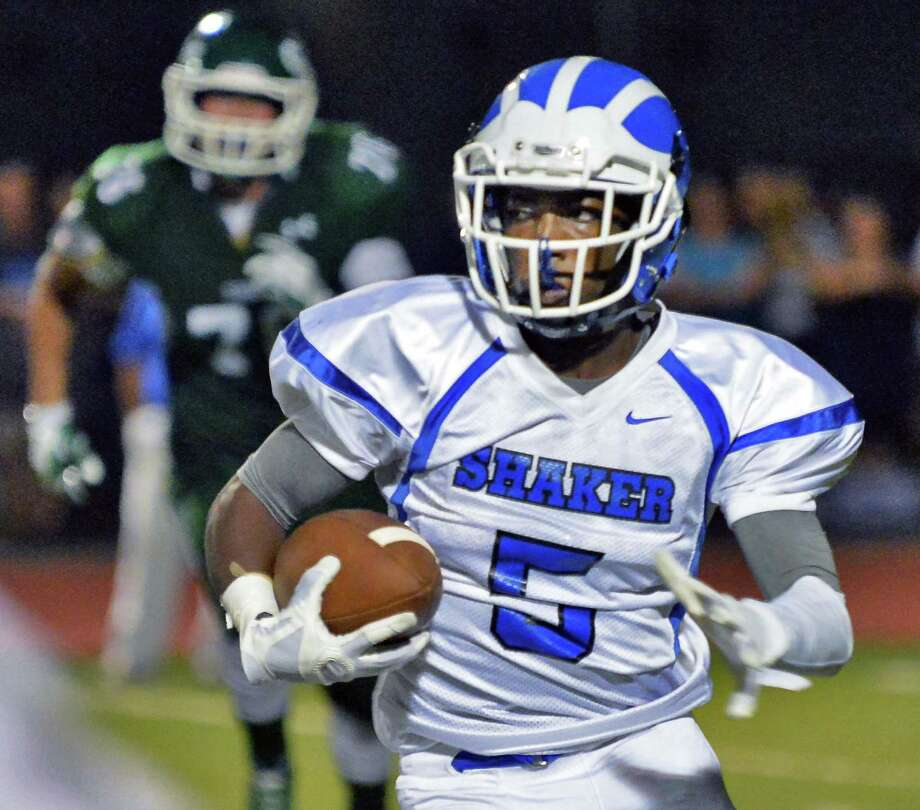 Shaker's #5 Ronel Forde carries the ball during Saturday night's game against Shenendehowa High Sept. 11, 2015 in Clifton Park, NY.  (John Carl D'Annibale / Times Union) Photo: John Carl D'Annibale / 00033300A