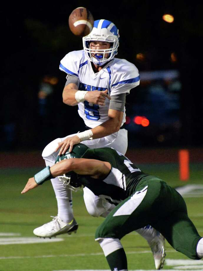 Shaker quarterback Brendan Mac Phee gets a pass off as he is hit by Shen's Richard Drum during Saturday night's game at Shenendehowa High Sept. 11, 2015 in Clifton Park, NY.  (John Carl D'Annibale / Times Union) Photo: John Carl D'Annibale / 00033300A