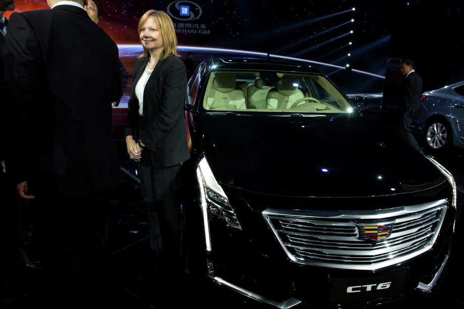 General Motors CEO Mary Barra, with a Cadillac CT6 sedan, takes part in a GM event in China this spring. Photo: Ng Han Guan, STF / AP