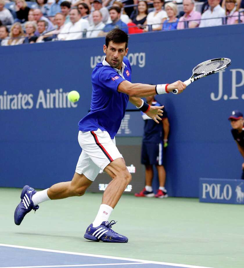Novak Djokovic, of Serbia, returns a shot to Marin Cilic, of Croatia, during a semifinal match at the U.S. Open tennis tournament, Friday, Sept. 11, 2015, in New York. (AP Photo/Julio Cortez) ORG XMIT: USO309 Photo: Julio Cortez / AP