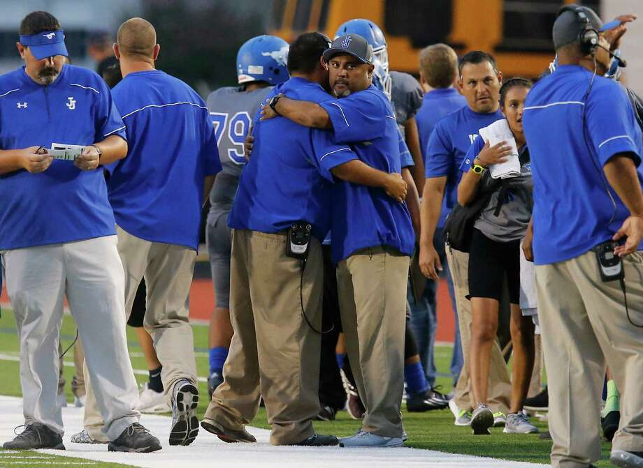Jay coaches embrace before the team's gave against Del Rio at Gustafson Stadium. Photo: Kin Man Hui /San Antonio Express-News / ©2015 San Antonio Express-News