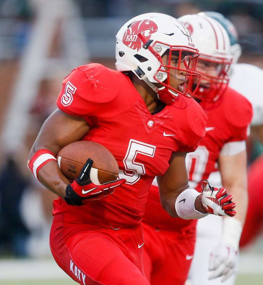 Katy running back Kyle Porter rushes with the ball against The Woodlands defense in the first quarter during a high school football game Friday, Sept. 11, 2015 in Katy, Tx. Katy won 14-7.(Bob Levey/For The Chronicle) Photo: Bob Levey, Houston Chronicle