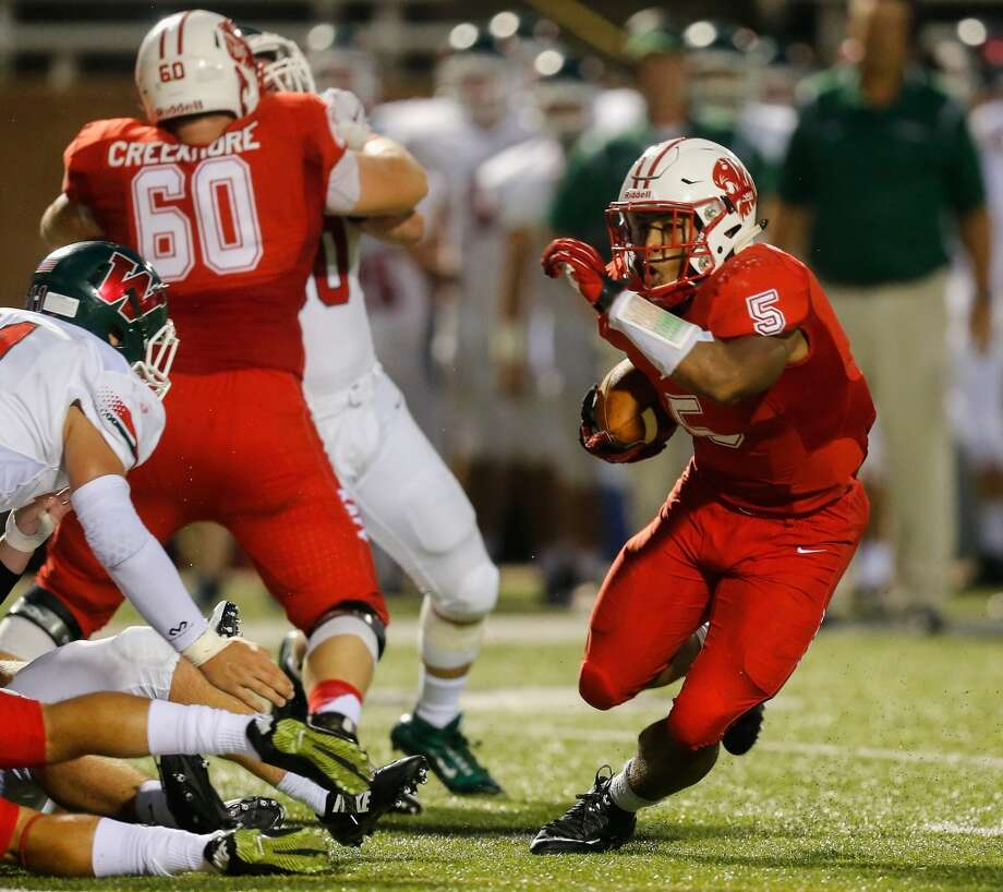 Katy running back Kyle Porter (5) bounces to the outside as he rushes in the second half against The Woodlands during a high school football game Friday, Sept. 11, 2015 in Katy, Tx. Katy won 14-7.(Bob Levey/For The Chronicle) Photo: Bob Levey, Houston Chronicle