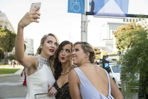 Laurie Diab, Shannon Eliot and Lauren Groff (left to right) snap a selfie while arriving at War Memorial Opera House to attend the San Francisco Opera Ball 2015: Moonlight & Music, in San Francisco, Calif., on Friday, September 11, 2015. The benefit ball celebrated San Francisco OperaÕs 93rd season.