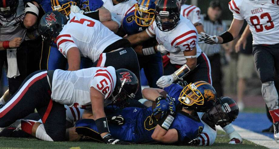 Brookfield's Robert Drysdale (9) run was just short of the goal line in the first half of the football game between New Fairfield and Brookfield high schools on Friday night, September 11, 2015, at Brookfield High School, Brookfield, Conn. Photo: H John Voorhees III / Hearst Connecticut Media / The News-Times