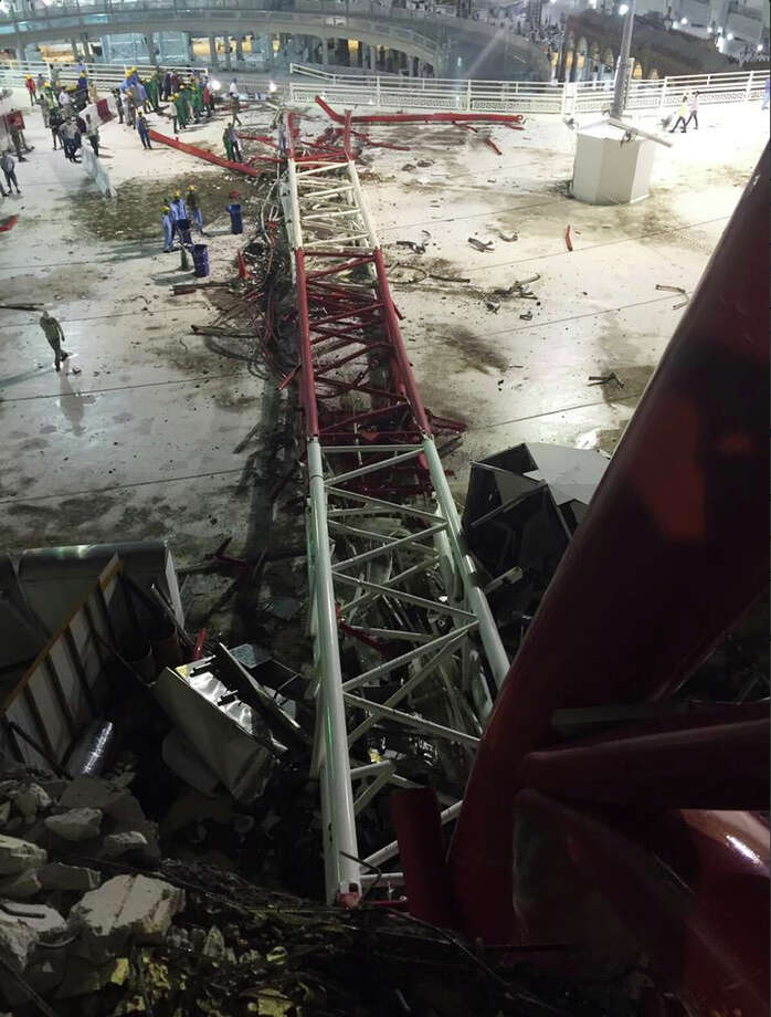 In this image released by the Saudi Interior Ministry's General Directorate of Civil Defense, a collapsed crane is seen over the Grand Mosque in Mecca, Friday, Sept. 11, 2015. The accident happened as pilgrims from around the world converged on the city, Islam's holiest site, for the annual Hajj pilgrimage, which takes place this month, killing dozens. The civil defense authority announced the collapse and a series of rising casualty numbers on its official Twitter account. (Saudi Interior Ministry General Directorate of Civil Defense via AP) Photo: Uncredited, HOGP / Associated Press / Saudi Interior Ministry General