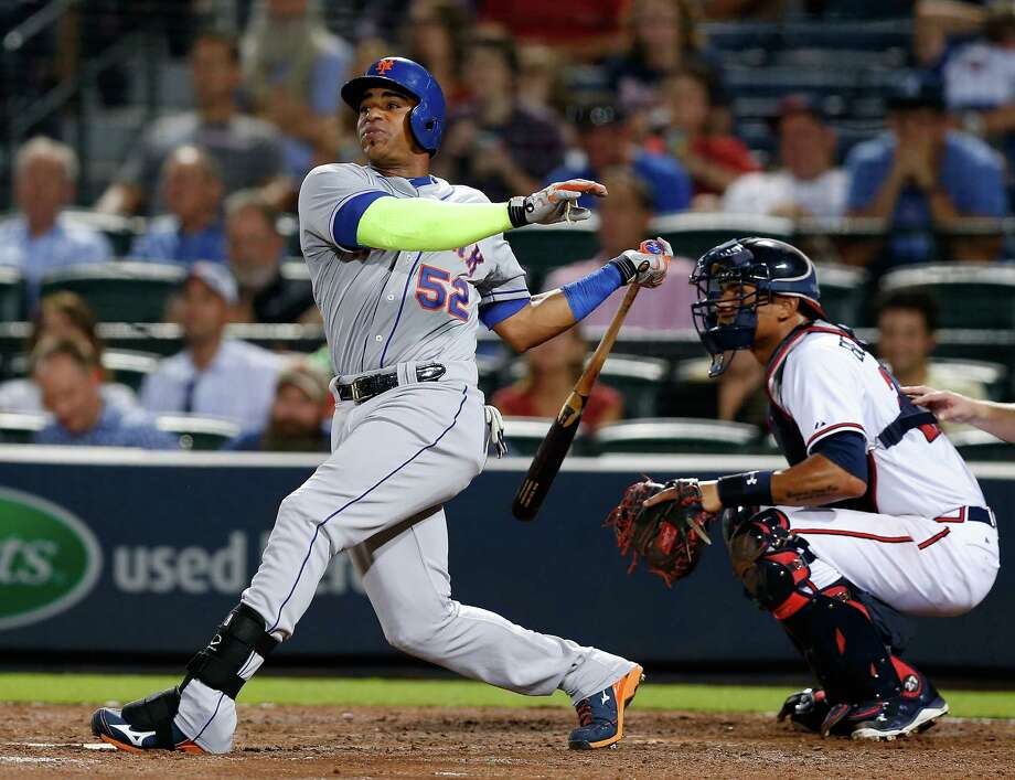 ATLANTA, GA - SEPTEMBER 11:  Centerfielder Yoenis Cespedes #52 of the New York Mets hits a 2-run home run in the eighth inning while catcher Christian Bethancourt #27 of the Atlanta Braves looks on during the game at Turner Field on September 11, 2015 in Atlanta, Georgia.  (Photo by Mike Zarrilli/Getty Images) ORG XMIT: 538594743 Photo: Mike Zarrilli / 2015 Getty Images
