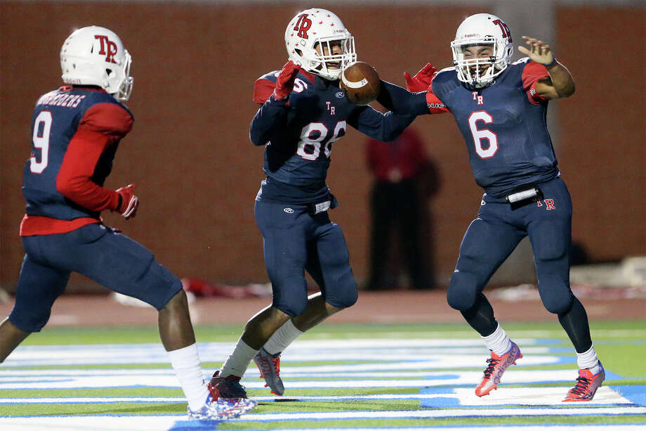 Roosevelt quarterback Bryson Carroll (from right) celebrates in the end zone with Justin Mann and Terrance Lewis after his seven-yard touchdown run during in the first quarter of their game with Judson at Heroes Stadium on Friday, Sept. 11, 2015.  MARVIN PFEIFFER/ mpfeiffer@express-news.net Photo: Marvin Pfeiffer, Staff / San Antonio Express-News / Express-News 2015