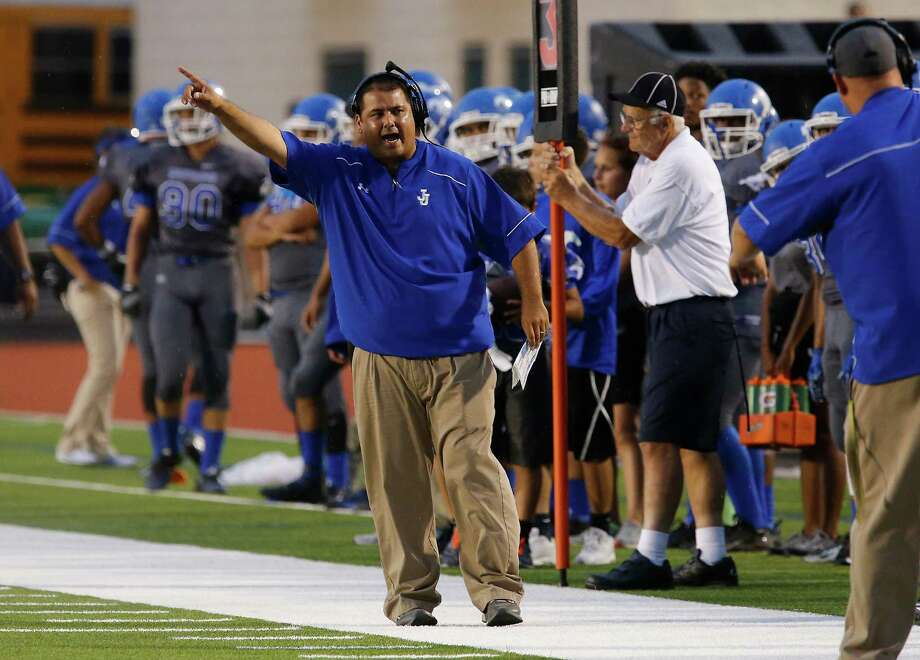 John Jay head football coach Gary Gutierrez calls out to his team to take the field against Del Rio at Gustafson Stadium on Friday, Sept. 11, 2015. Photo: Kin Man Hui /San Antonio Express-News / ©2015 San Antonio Express-News