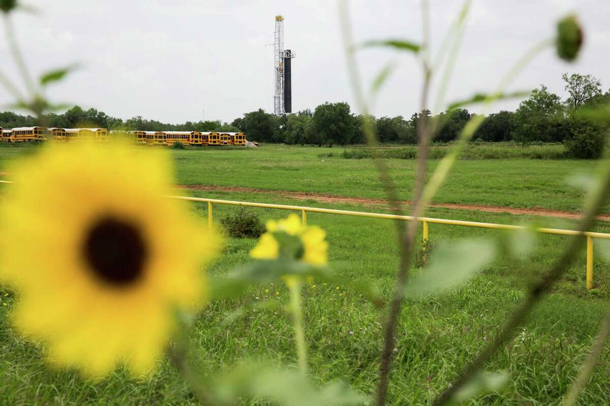 An oil rig stands on the edge of the Cotulla High School campus on May 20, 2015 in Cotulla, Texas.