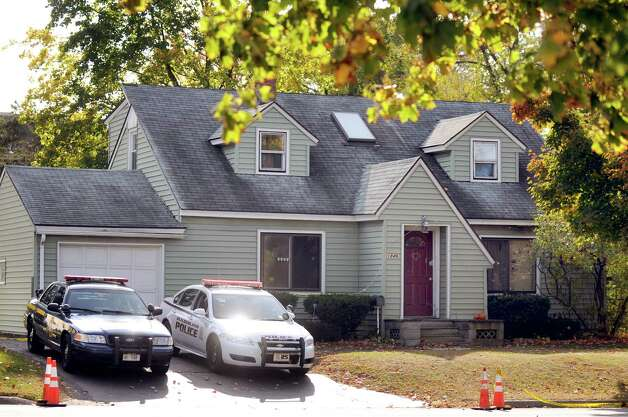 State and local police keep watch on 1846 Western Ave. on Tuesday, Oct. 14, 2014, in Guilderland, N.Y. Jin Chen and Hai Yan Li and their sons Anthony, 10, and Eddy, 7, all of Chinese decent, were found dead inside the home last Wednesday. (Cindy Schultz / Times Union) Photo: Cindy Schultz / 10029034A
