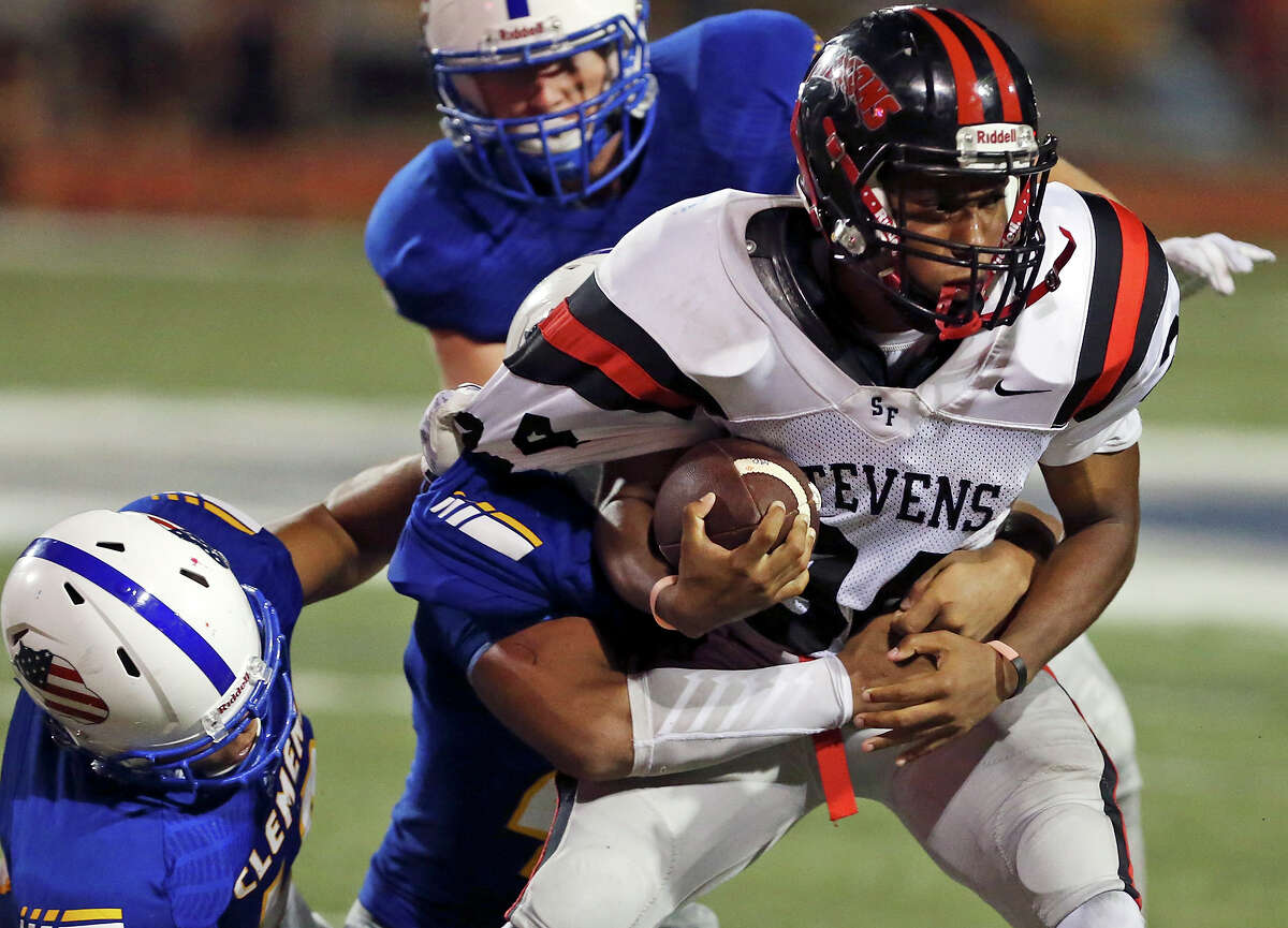 Stevens' De Vante Donald tries to shake the tackle of Clemens defenders during second half action on Sept. 11, 2015 at Lehnhoff Stadium. Clemens won 56-21.