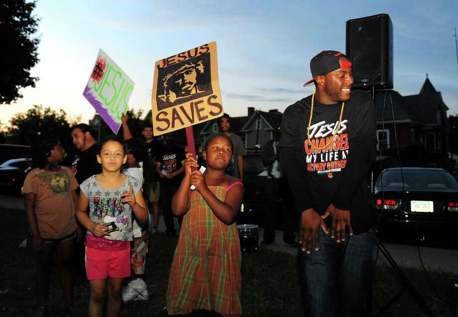 """A """"Stop the Violence"""" rally by Victory Outreach Church was held in the courtyard at the Greene Homes housing project off of Highland Avenue in Bridgeport, Conn., on Wednesday Sept. 9, 2015. Victory Outreach International has over 700 churches around the world, but locally there is a Victory Outreach church on Jane Street in Bridgeport. Members of the ministry from Chicago and Los Angeles were present to entertain with rap, give their testimony and pray with residents. Photo: Christian Abraham / Hearst Connecticut Media / Connecticut Post"""