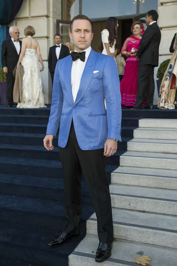 """The 93rd San Francisco Opera season opening night, with an Opera Ball themed """"Moonlight & Music,"""" called for high glamor, and the fashion trend for women ranged from ball gowns with fluid skirts to patterned florals. But the real news was colored or textured dinner jackets for men. Andrew Hinek, a real estate broker from New York, wears a Tom Ford jacket, one of the more noticeable pops of color on opening night. Photo: Laura Morton, Special To The Chronicle"""