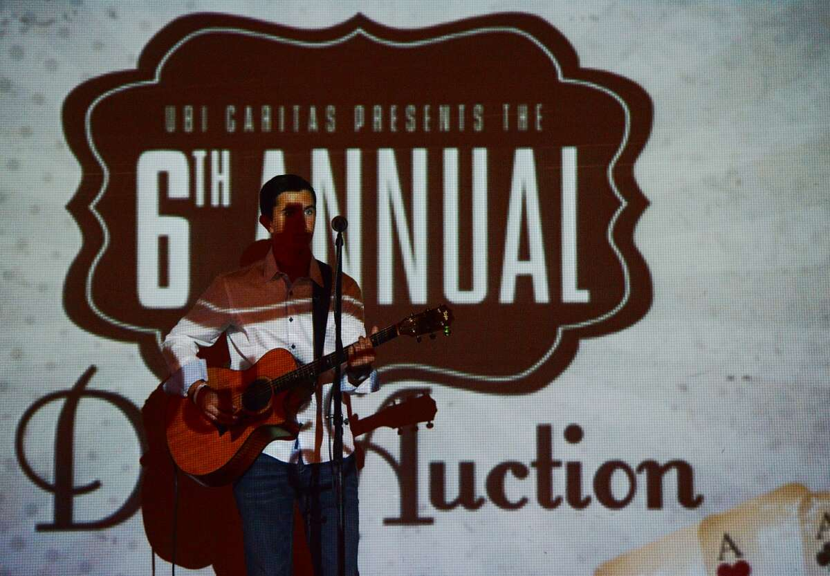 Bryce Shaver performs before the beginning of Wednesday's live auction. Ubi Caritas hosted their 6th annual Date Auction at Madison's on Dowlen on Wednesday night. The evening included life music during a cocktail hour, a silent auction, and a live auction. Proceeds from the auctions will go to the Ubi Caritas Children's Health Education Initiative. Photo taken Wednesday 9/10/14 Jake Daniels/@JakeD_in_SETX