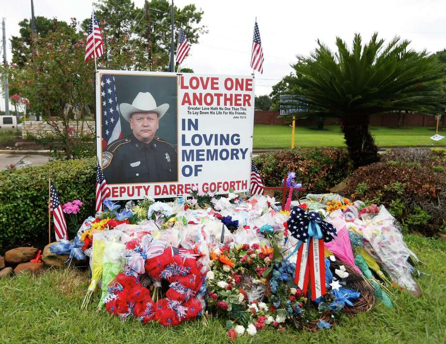 The memorial for Deputy Darren Goforth photographed on Friday, Sept. 11, 2015, in honor of Goforth, who was killed two weeks ago at this Chevron at West Road and Telge, as he refueling his vehicle. Photo: Karen Warren, Houston Chronicle / © 2015 Houston Chronicle