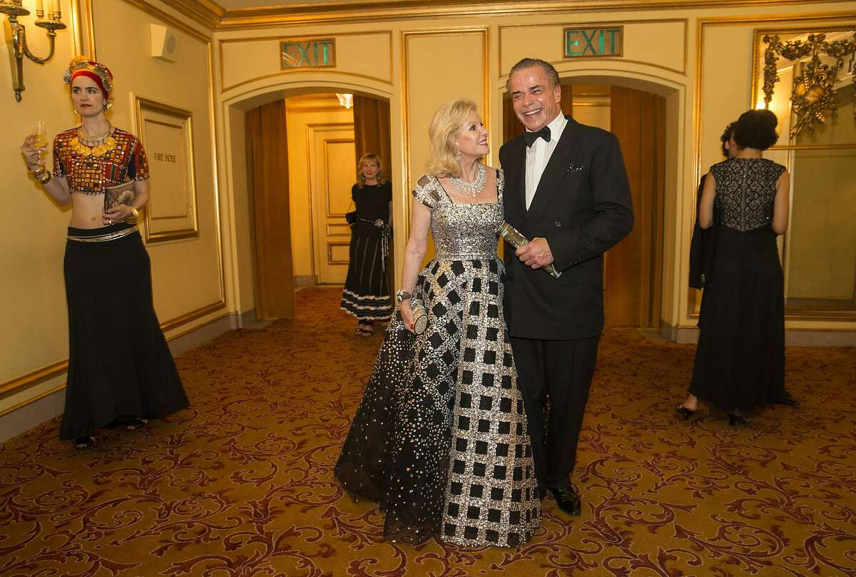 Dede Wilsey and Boaz Mazor (right) head back to their seats after intermission during the San Francisco Opera Ball 2015.