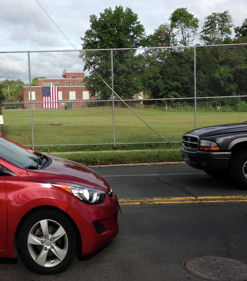 The enormous American flag used during Dolan Middle School's 9/11 tribute is easily visible from the traffic on busy Hope Street. Photo: Angela Carella / Hearst Connecticut Media / Stamford Advocate