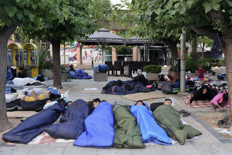 Scores of refugees, mostly from Afghanistan, sleep on the ground at Victoria Square in Athens. Photo: Milos Bicanski, Getty Images