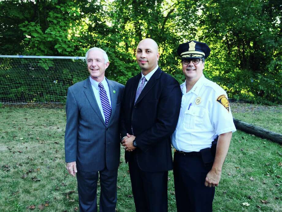 Bridgeport Police Officer Carlos Vazquez, center, stands with Mayor Bill Finch and Police Chief Joseph Gaudette. On Friday, Sept. 11, 2015. the Bridgeport Elks honored Firefighter Timothy Gies and Vazquez as Firefighter and Police Officer of the year. The Elks also honored the lives that were lost in the attacks on the United States on Sept.11, 2001. Photo: Contributed Photo