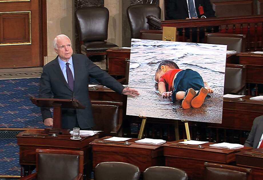 Sen. John McCain, R-Ariz., noting the story of a drowned 3-year-old refugee, urged stronger leadership from President Obama on Syria.  Photo: HOGP / US Senate Television