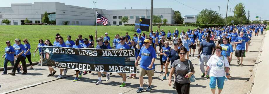 An estimated 8,000 participants enjoyed the gorgeous weather and walked the Sam Houston Toll Road access roads between West Road and Fallbrook in support of police officers today.  Photo: Craig Hartley, For The Chronicle / Copyright: Craig H. Hartley