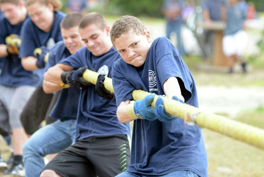 Fourteen-year-old Franklin Berry, with the Seymour Jr. Fire Department, competes in a tug of war during the 44th annual Engine 260 Antique Fire Apparatus Show and Muster at Eisenhower Park in Milford, Conn. Saturday, Sept. 12, 2015. Photo: Autumn Driscoll / Hearst Connecticut Media / Connecticut Post